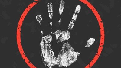 White hand print inside of a red circle on a dark gray background