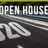 Open House text overlaying empty road
