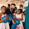 Joseph Randazzo with children at a medical clinic