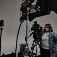 Alyssa Morgan peering through camera