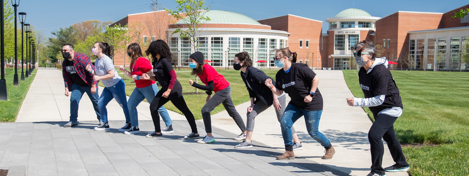 A variety of students in a line ready to run a race