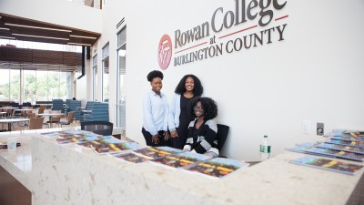 Students at the Student Success Center reception desk