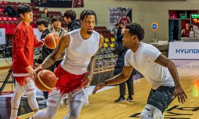 Chris McCullough and Louis Baltazar playing basketball in South Korea